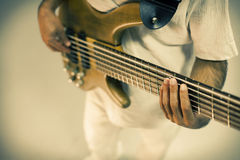 Bass Guitarist. Close up bass guitar and guitarist isolated on white Royalty Free Stock Images