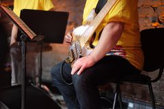 The bass guitarist during the intermission of the concert Royalty Free Stock Images