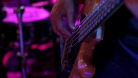 Bass-guitarist perform at a concert stock video footage