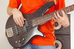 Bass guitarist playing the electric bass guitar Royalty Free Stock Images