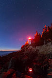 Bass harbor head light, Acadia. In the night with sky full of stars Royalty Free Stock Photo