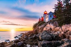 Bass Harbor Head lighthouse at sunset, in Maine. Bass Harbor Head lighthouse at sunset. Bass Harbor Head Light is a lighthouse located within Acadia National stock photo