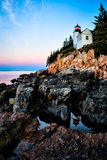 Bass Harbor Light sunrise. While photographing the sunrise on the Maine coast I was able to catch a great reflection. I loved how the front end slopes like the royalty free stock photos