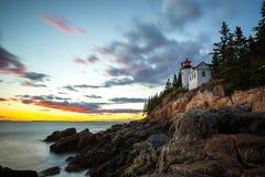 Bass Harbor Lighthouse en la puesta del sol Foto de archivo libre de regalías