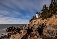 Bass Harbor Lighthouse in Maine. With Rocky Coast royalty free stock image