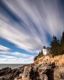 Bass Harbor Lighthouse in Maine. With Rocky Coast royalty free stock photo