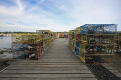 Bass Harbor, Maine. Lobster traps and fishing equipment on the docks of Bass Harbor, Maine, on a sunny summer afternoon stock photo