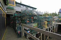 Bass Harbor, Maine. Lobster traps and fishing equipment on the docks of Bass Harbor, Maine, on a sunny summer afternoon royalty free stock photo