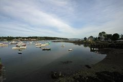 Bass Harbor, Maine. Town of Bass Harbor, Maine, and its harbor on a quiet summer afternoon royalty free stock image
