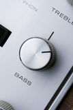 Bass knob. The bass knob on an old stereo stock image