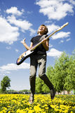 Bass player. Young bass player jumping in the city Stock Photography