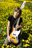 Bass player. Young bass player in the field Stock Photo