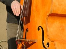 Bass player. Detail of Musical Instruments of a jazz band royalty free stock images