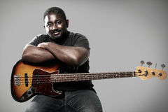 Bass player. An american african bass player on white background Stock Photos