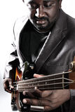 Bass player. An american african bass player on white background Stock Image