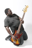 Bass player. An american african bass player on white background Stock Photo