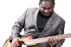 Bass player. An american african bass player on white background Royalty Free Stock Images