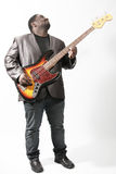 Bass player. An american african bass player on white background Royalty Free Stock Photos