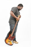 Bass player. An american african bass player on white background Royalty Free Stock Photo