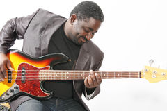 Bass player. An american african bass player on white background Stock Images