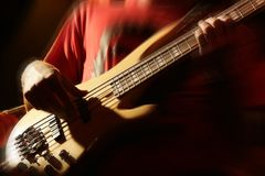 Bass player. Playing on the concert . zooming to strings Stock Photo