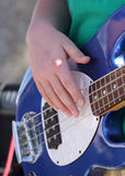 Bass player. Close up of the right hand of a base player with focus on fingers Stock Images