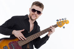 Bass player with attitude. Playing guitar gently in love with music Stock Photos