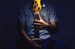 Bass Player and His Guitar Stock Images