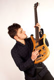 Bass player looking at his instrument Royalty Free Stock Photos