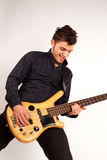 Bass player looking at his instrument Stock Image