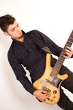 Bass player looking at his instrument Stock Photo