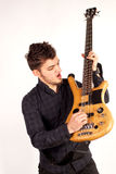 Bass player looking at his instrument Stock Photos