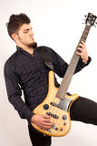 Bass player looking at his instrument Royalty Free Stock Photography