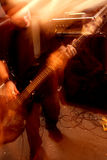 Bass player movement 2. Blurry atmospheric abstract noisy hazy image of a bass player rippin' thru songs. Shot with slow shutter speed and flash for lots of Royalty Free Stock Photos
