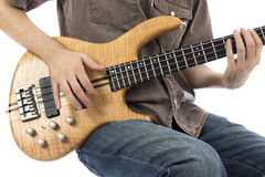 Bass player playing his bass guitar. Bass guitarist with his bass guitar (Series with the same model available Royalty Free Stock Images