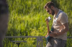 Bass player plucks the strings royalty free stock image