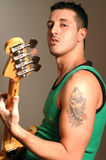 Bass player with tattoo. And attitude Stock Photography