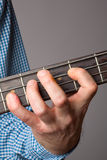 Bass players left hand Stock Photography