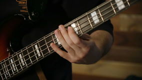 Bass playing rock n roll. Close up shot of bass playing rock n roll stock footage