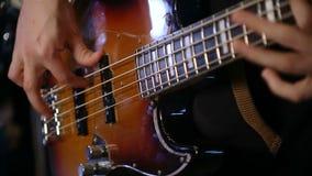 Bass playing rock n roll. Close up shot of bass playing rock n roll stock video