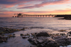 Bass Point Cargo Loader Pier at Sunrise Stock Photo