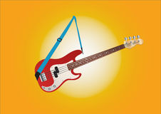 Red and white bass guitar hanging on blue stripe at sunny background Royalty Free Stock Image