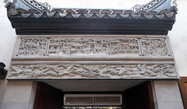 Bass-relief plaque on the doorway of the house in the Grand Canal, ancient town of Yuehe in Jiaxing, China. Richly carved stone bass-relief plaque on the doorway royalty free stock photos