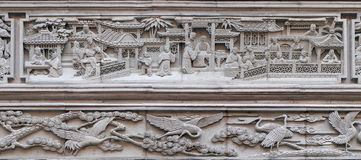 Bass-relief plaque on the doorway of the house in the Grand Canal, ancient town of Yuehe in Jiaxing, Zhejiang Province, China. Richly carved stone bass-relief stock photo