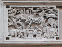 Bass-relief plaque on the doorway of the house in the Grand Canal, ancient town of Yuehe in Jiaxing, Zhejiang Province, China. Richly carved stone bass-relief stock images