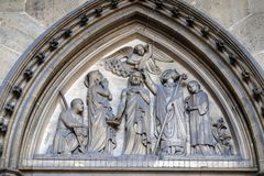 Bass relief on the portal of the Basilica of Saint Clotilde in Paris royalty free stock photos