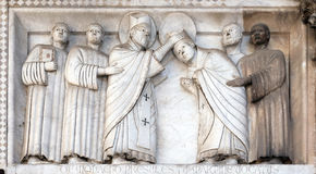 Bass-relief representing the Stories of St. Martin, Cathedral of St. Martin in Lucca, Italy stock photography