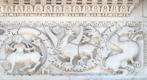 Bass relief on San Michele in Foro Church in Lucca, Italy Royalty Free Stock Photography