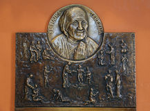 Bass relief with scenes from the life of Saint Mother Teresa Stock Images