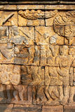 Bass-relief on the wall in Borobudur temple Royalty Free Stock Photos